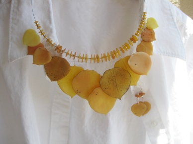 aspen leaf necklace earrings white shirt indoors